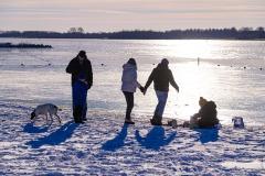 familie bij strand nulde